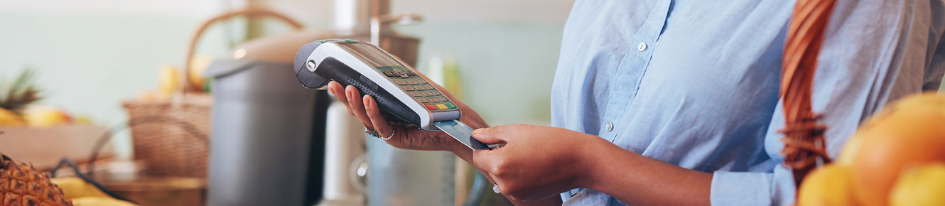 woman taking payment with card reader